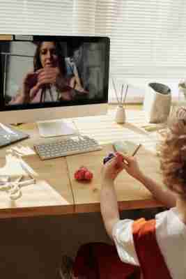 teaching sel online through an imac to a child using kinetic sand