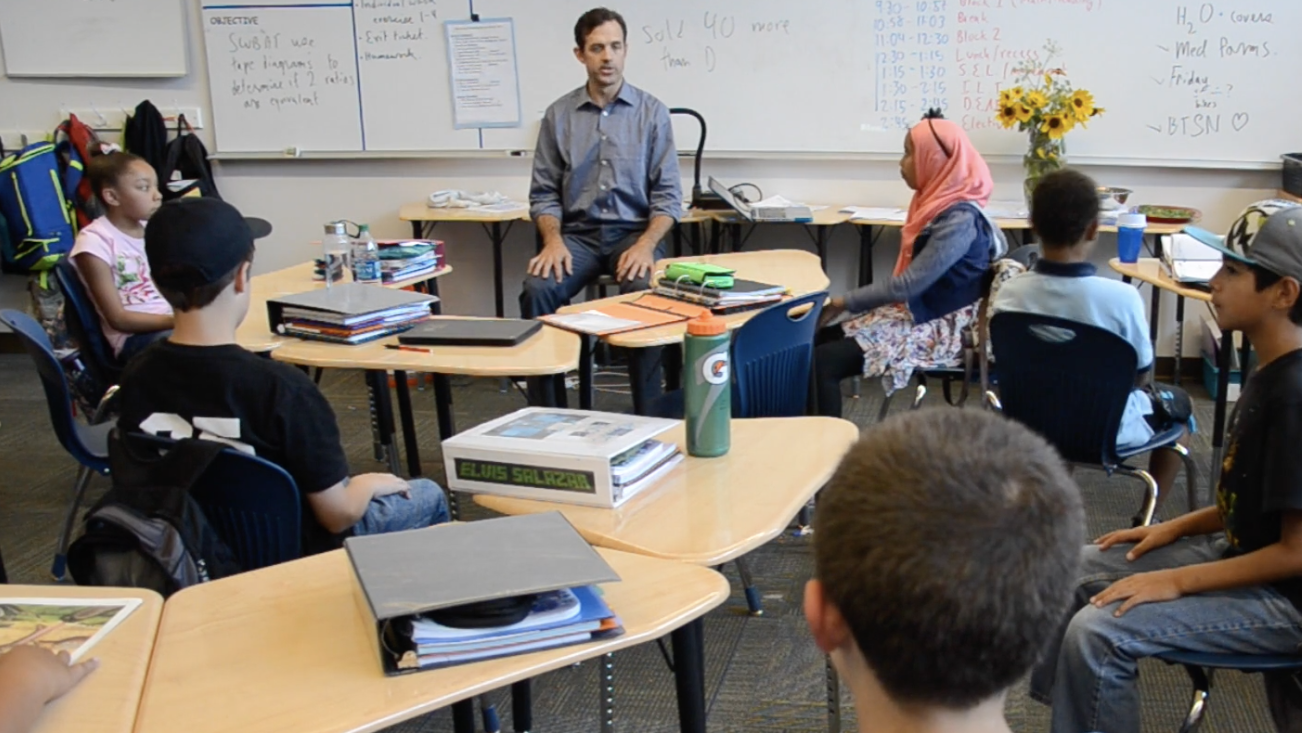 A teacher using a trauma-informed classroom for middle school students